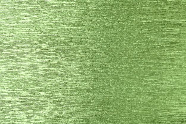 Strutturale di verde di carta ondulata ondulata, primo piano.