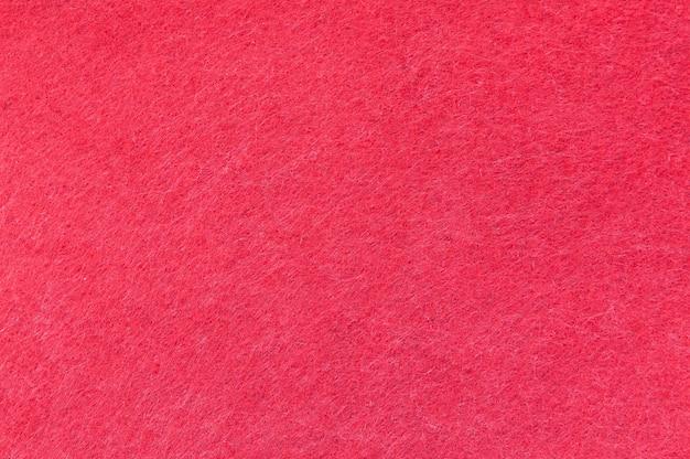 Strutturi il fondo di velluto rosso o della flanella come modello dello sfondo o della carta da parati per la decorazione