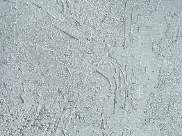 Strutturi il gesso blu decorativo che imita la vecchia parete della sbucciatura.