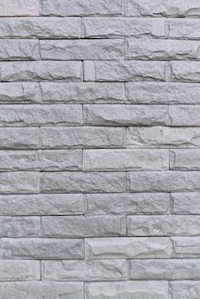 Strutturi il vecchio muro di mattoni bianco per fondo