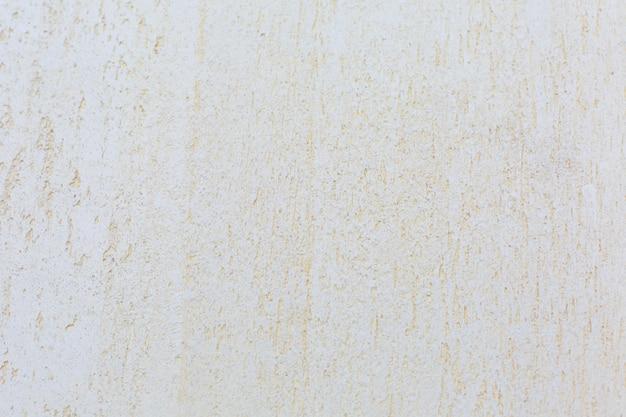 Stucco strutturato sul muro. fondo ruvido della parete di lerciume.