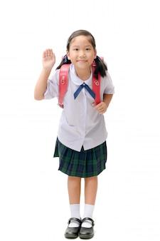 Studente asiatico sveglio con la borsa di scuola isolata