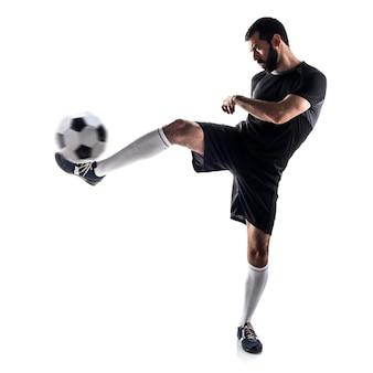 Studente latino ragazzo calci atleta