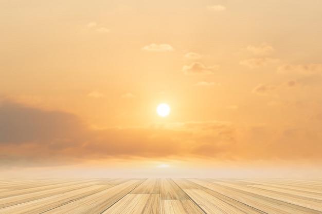 Sul pavimento di legno e sullo sfondo del cielo quando il sole tramonta
