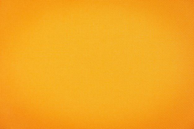 Superficie astratta e texuture delle trame di tessuto di cotone arancione
