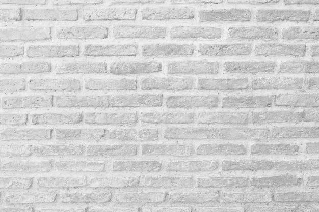 Superficie del fondo bianco d'annata del muro di mattoni.