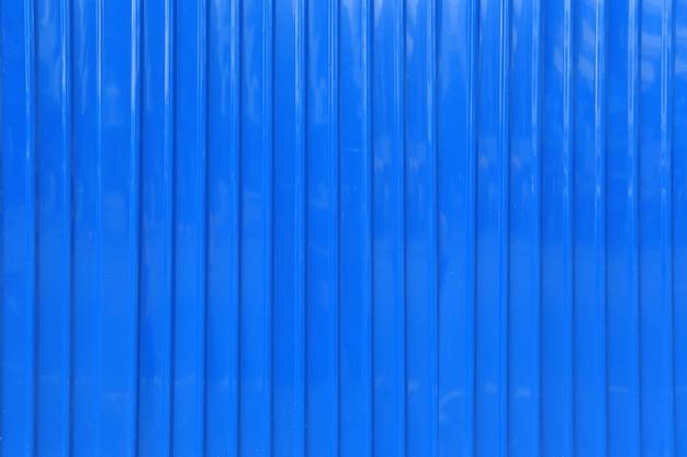 Superficie del fondo blu della parete dello zinco.