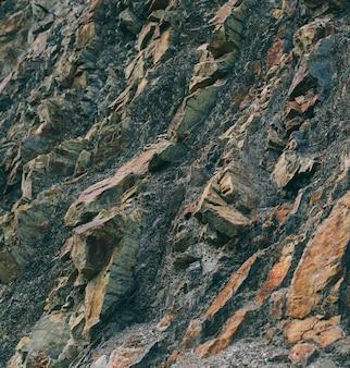 Superficie del marmo con tinta marrone trama di pietre e sfondo trama di roccia