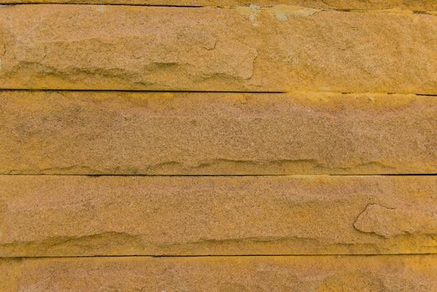 Superficie del muro in pietra di laterite con cemento