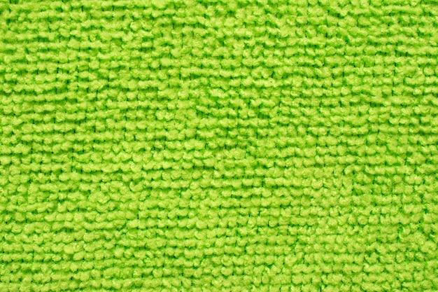 Superficie del panno verde in microfibra, macro modello tessile sullo sfondo