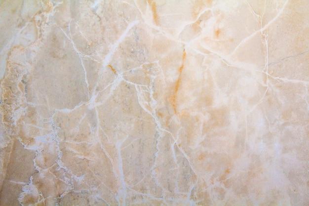 Superficie del primo piano del modello di marmo ai precedenti di marmo di struttura del pavimento, modello di marmo astratto giallo
