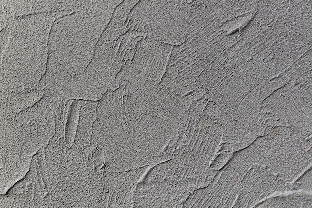 Superficie della parete grigia ruvida
