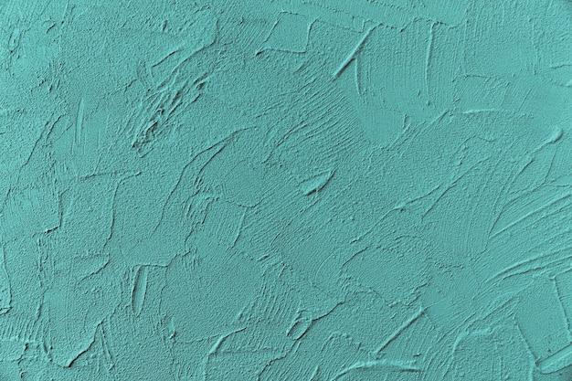 Superficie della parete ruvida dipinta di blu