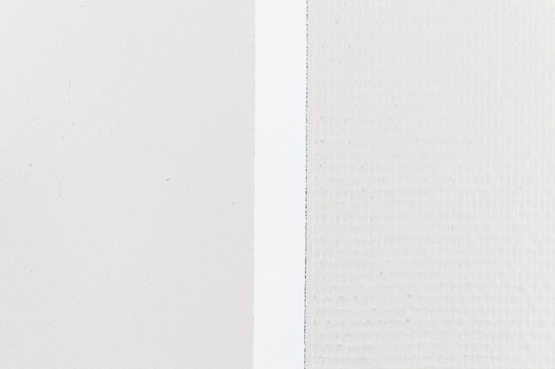 Superficie della parete ruvida e liscia con divisione