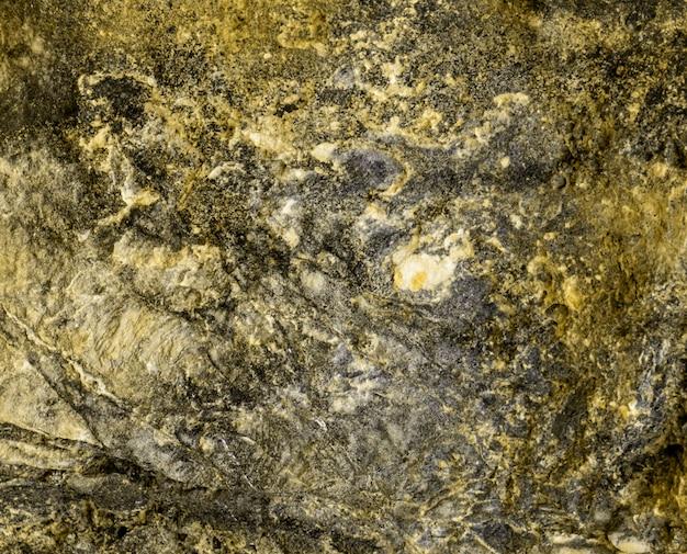 Superficie dello strato di roccia marrone per sfondo texture