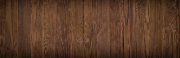 Superficie di legno scura di una superficie del tavolo o del pavimento, struttura di legno cupa