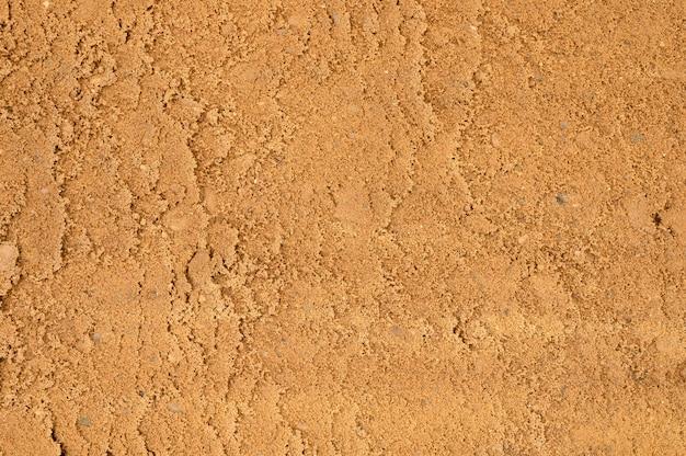 Superficie di sabbia strutturata come sfondo, vista dall'alto