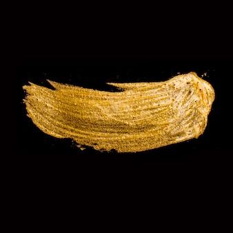 Superficie dorata liscia del primo piano