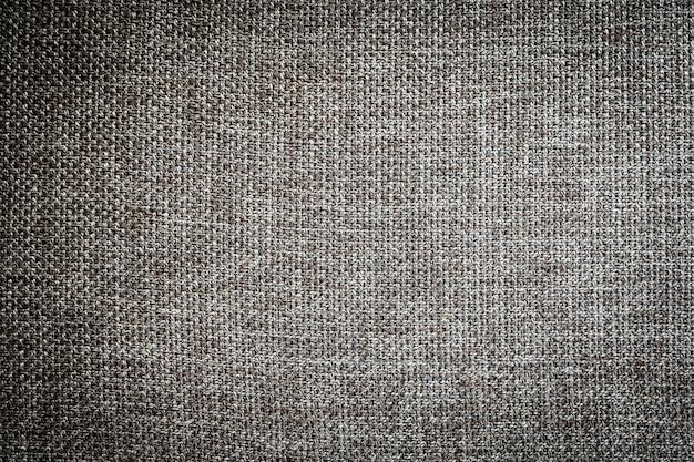 Superficie e texture della tela di cotone tessuto grigio e nero