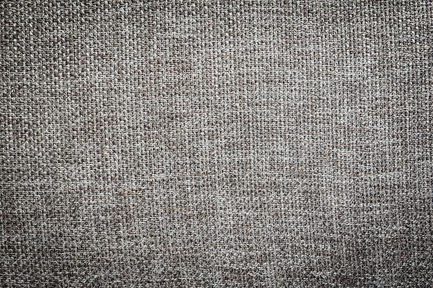 Superficie e texture in tela di cotone tessuto grigio e nero