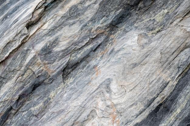 Superficie grigia della pietra di marmo con strisce a strisce.