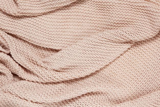 Superficie strutturata del plaid in cotone ondulato lavorato a maglia