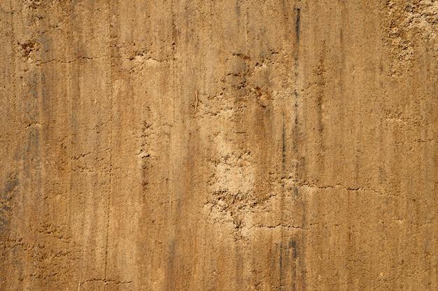 Superficie strutturata della sabbia e della terra come fondo, vista superiore