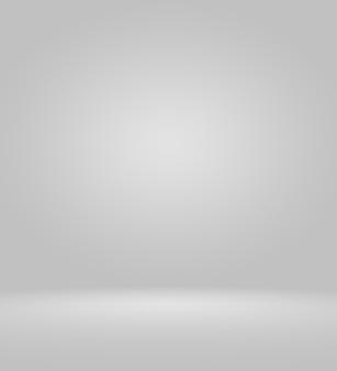 Svuoti il fondo bianco e grigio dello studio