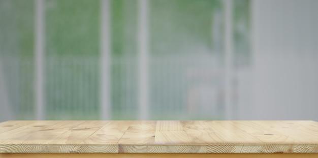 Svuoti la tavola di legno rustica della tavola con fondo vago con lo spazio della copia