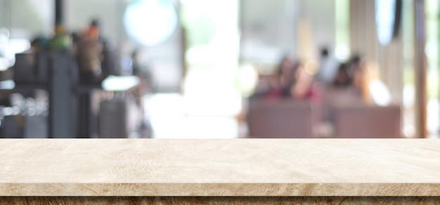 Svuoti la tavola marrone del cemento sopra il montaggio del fondo, del prodotto e dell'alimento del caffè della sfuocatura