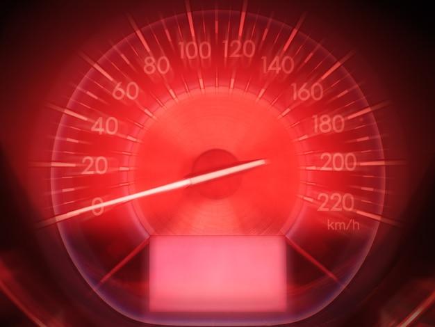Tachimetro astratto dell'automobile nel tono rosso