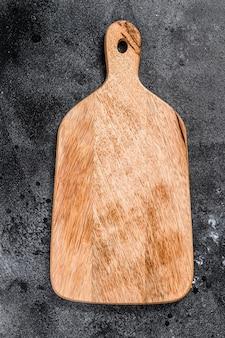Tagliere in legno. vista dall'alto. copia spazio