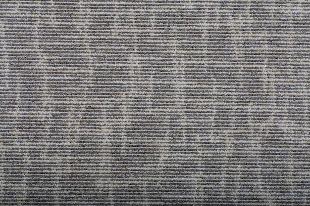 Tappeto che copre lo sfondo. modello e trama del tappeto di colore grigio. copia spazio