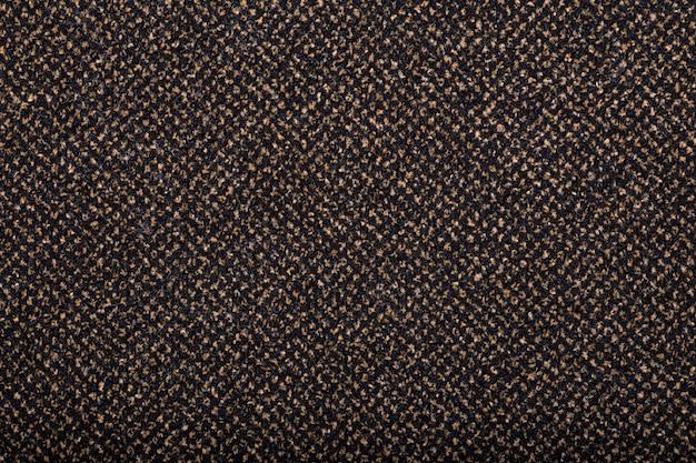Tappeto che copre lo sfondo. modello e trama del tappeto di colore marrone. copia spazio