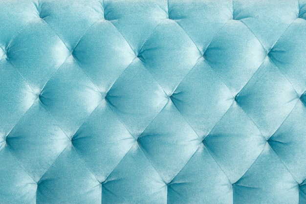 Tappezzeria del sofà trapuntata velour di lusso, struttura o fondo della decorazione domestica. design dei mobili, interni classici e concept materiale vintage reale
