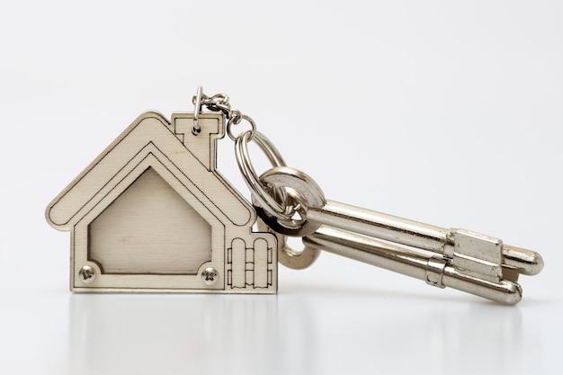 Tasto home su tabel. concetto per gli agenti immobiliari.