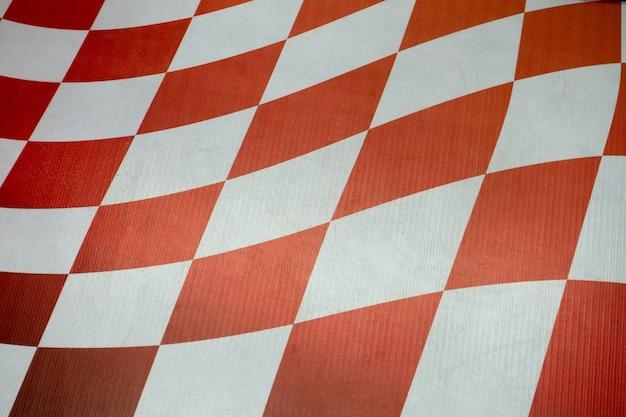 Tavola a scacchi rossa e bianca del fondo
