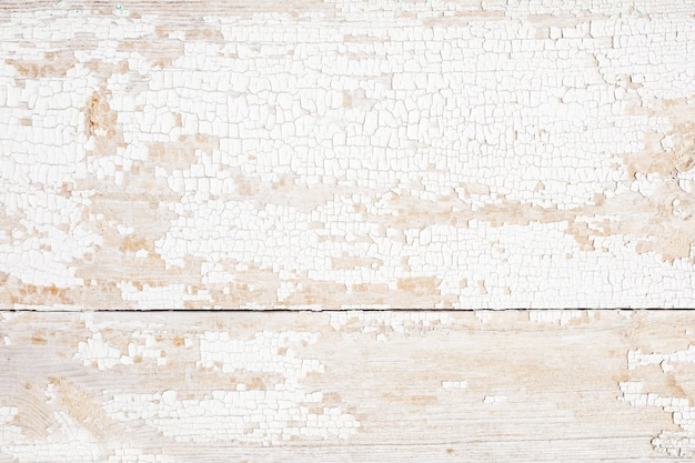 Tavola di legno di sfondo con vernice incrinata. struttura di legno a buccia di colore