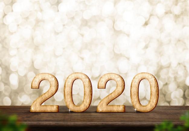 Tavola di legno marrone del buon anno 2020on al bokeh della scintilla dell'oro