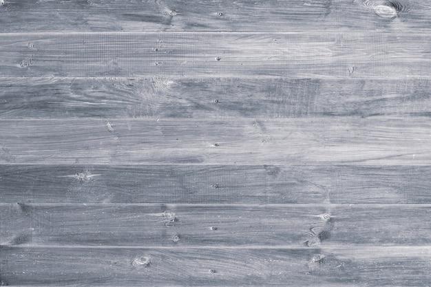 Tavole di legno grigie, assi. strisce orizzontali su parquet.