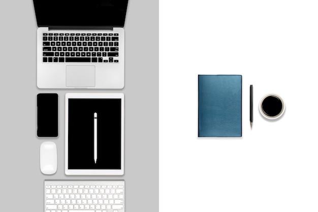 Tavolo da ufficio con computer portatile, tavoletta digitale, telefono cellulare e accessori.