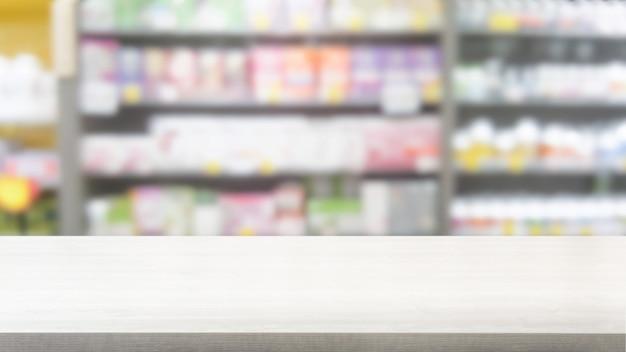 Tavolo in legno in farmacia o farmacia sfondo.