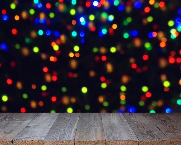 Tavolo in legno vuoto. sfondo di capodanno