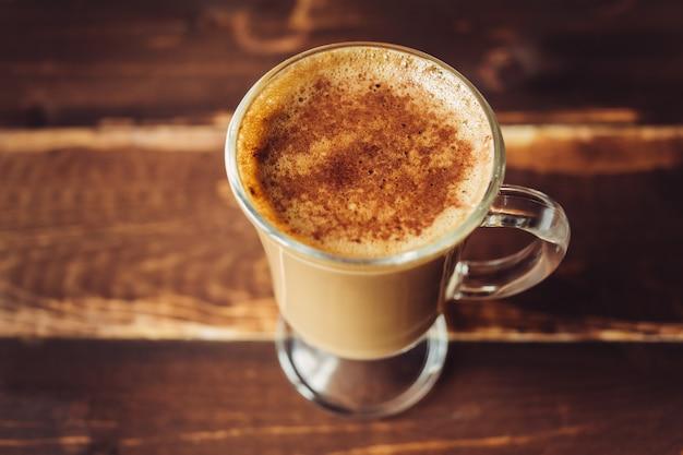 Tazza di mattina del fondo del cappuccino, spazio della copia