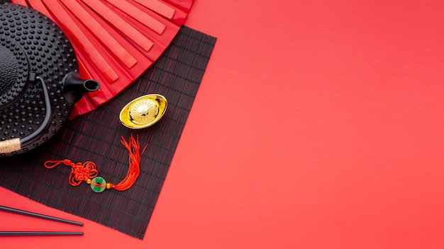 Teiera e ciondolo capodanno cinese