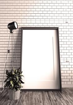 Telaio e lampada sul muro di mattoni