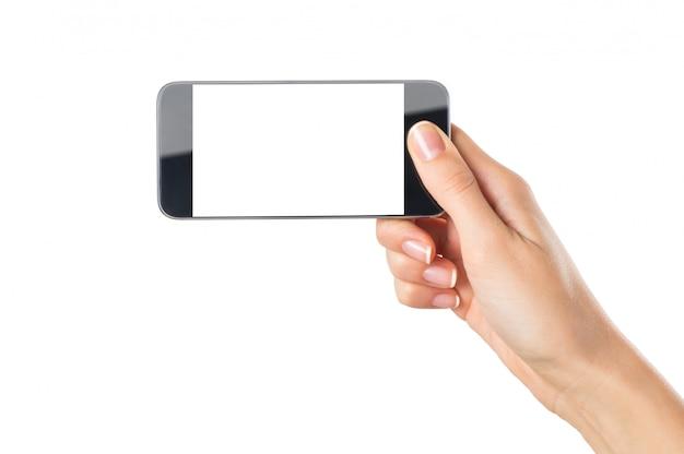 Telefono cellulare della tenuta della mano della donna