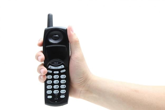 Telefono nella mano isolata su bianco
