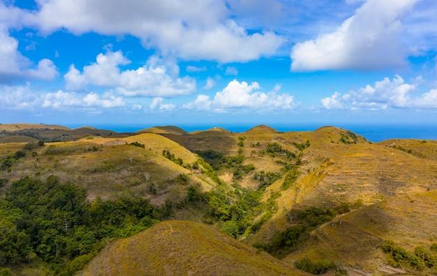 Teletubbies hill. drone shot tropical savanna hills a nusa penida, bali - indonesia