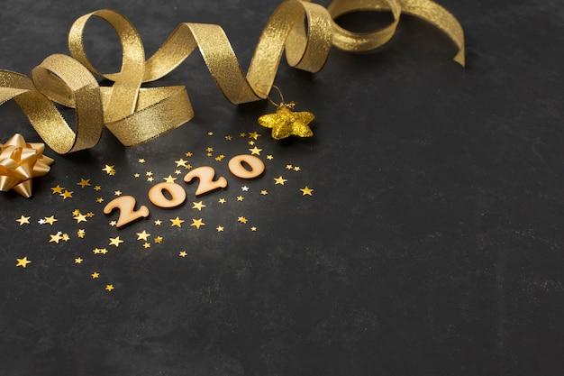 Tema dorato di alto angolo per il nuovo anno